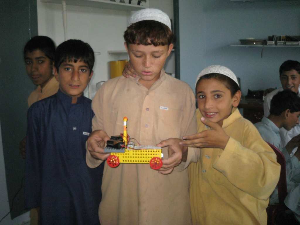Local boys from Bagrami Village learning how to design and build their own bots.