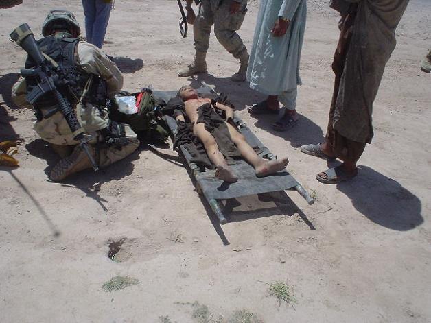 An IED casualty being treated on the scene, Tarin Kowt, Oruzgan.