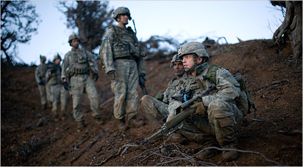 American infantry stripped down to as light as they can possible be with all the modern force protection gear.  There is only one way to fight insurgents in mountainious terrain and that is with no body aromor, no helmets, just a little food, water and ammo. Anyone who thinks they can do thte job in body armor and helmets is a deluded fool who have never humped the mountains of eastern Afghanbistan.  Photo by Tyler Hicks of the New York Times