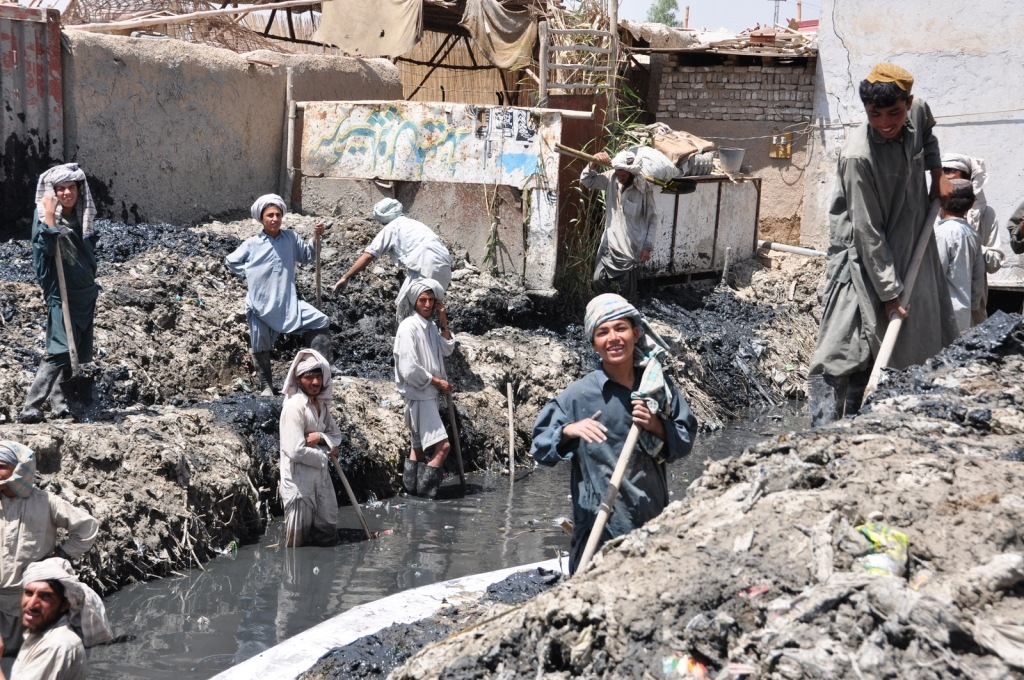 Cleaning the central canal in Kandahar City - not the most pleasent work but it pays well