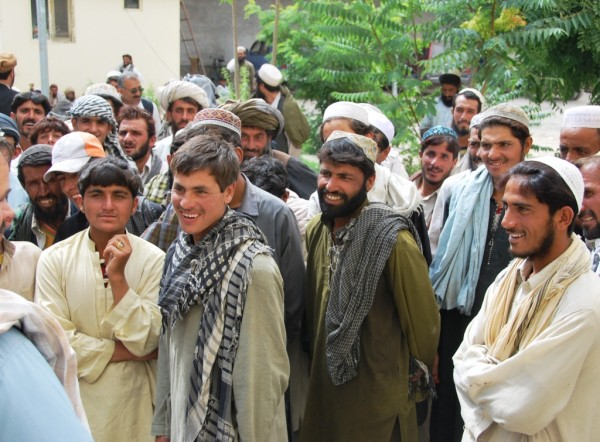 Panjwayi Tim (cropped out on his request) rapping with some of the workers in Pashto.  The locals are always happy to hear us trying their difficult language.