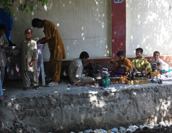 Some boys in Jalalabad working out in the shade (104 during the day now)  - guess what their Dad does for a living?