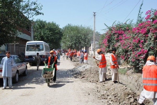 Building roads in downtown Jalalabad the old fashion way