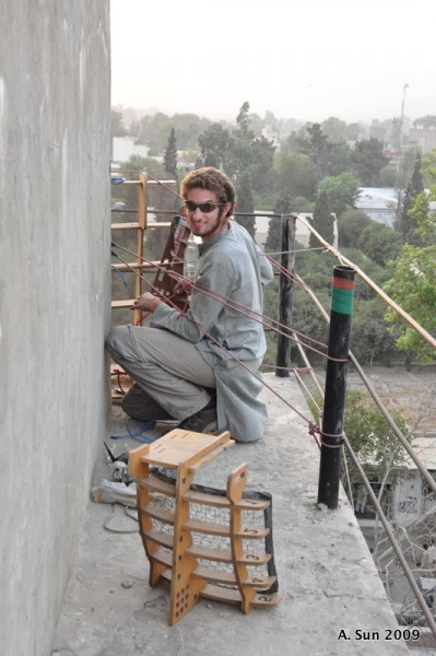 Keith Berkoben from MIT installing Fab Fi links on the largest water tower in Jalalabad