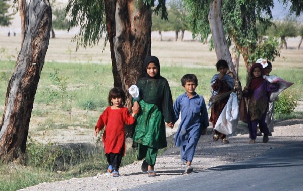 Children from a refugee camp outside of Jalalabad heading out to scavage for animal forage