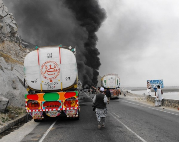 The first two tankers have been hit with multiple rounds and are leakng JP 8 all over the road