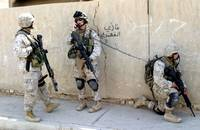 Paul (on the left) with his Bennelli pump action 12 gauge in Ramadi talking to one of his company commanders. The Iraqis could handle units which returned fire and withdrew in their vehicles. They could not handle units who dismounted and directly assaulted them. Direct assaults like that break up the cycle of violence by stripping the bad guys of experience fighters who might be able to keep their wits in the face of direct assault by heavy infantry. Less experience cadres have three options; stand and die, run and die, or quickly surrender