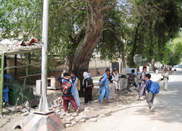The day after the bike IED attack local school children exam the scene