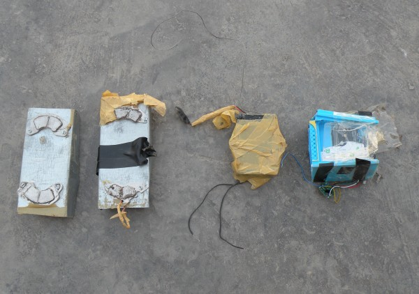 This is what local magnetic IED's look like.  They are big, obvious, not too powerful and it is hard to imagine that they were attached to the fule truck for very long without being spotted.   My guess is these things are being attached to the rear truck of these fule convoys at the customs station about 4 miles to the east.