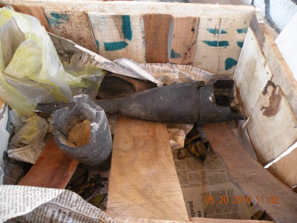 20 May - A bunch of crates full of bananas spilled out of the burning van as the driver abruptly pulled off the road and bailed out - look at what was underneath the bananas - old crappy nasty Soviet ordnance.  The Sov's used TNT based explosives for their military - we use C4 and other much more stable explosives for ours.  Old soviet rounds tend to have rust all over them and to leach out a clear chemical smelling fluid called Nitro Glycerine (I know how much more stupid and irresponsible can you be) which is unstable and prone to ignite at the most inoppurtune times.