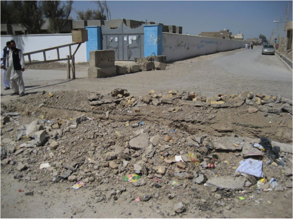 The first group of attackers dismounted here due to road construction and assaulted through the gate.  The first attacker detonated his vest here killing the ABP guard at this gate.
