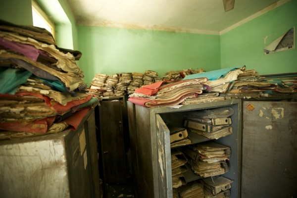 This is the land title storage room of the Nangarhar Provincial Agriculture Department. Some of these papers date back a hundred years and fall apart if you touch them. They are not cateloged or organized
