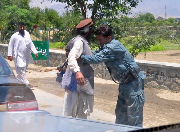 Look at the body language here - the guy getting searched has the classic Taliban look; long hair, untrimmed beard, Pakol and high water pants.