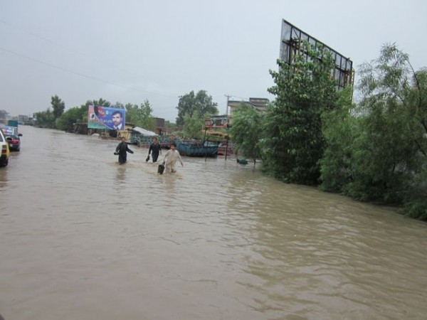 "Wednesday 25 July the second ""hundred year"" flood in less than a year hit Jalalabad following a morning of torrential rain. This is the main road heading towards the airport."