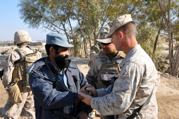 "On the way back to base LtCol Ellison stops to present a battalion coin to an Afghan policeman telling him he earned it by always being at his post with his weapon and controlling his intersection like a professional which the Marines find ""motivating"".  This is counterinsurgency 101 in action where small acts of recognition provide huge amounts of motivation"