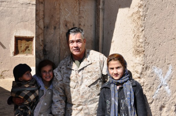 Navy Commander Martin Sepulveda with Zarmina and her sister Sharifa. Zarmina who is 12 or 13 years old is the local school teacher