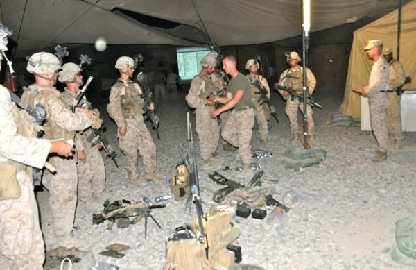 This night patrol brief started with all the Marines gear on the ground.  They were then searched by their patrol leader and platoon sergeant.  No ipods, tobacco lighters, matches, or any other no essential items are allowed and as every good Marine Sgt knows you inspect what you expect