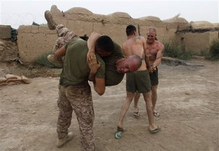 Marines engaging in a little physio on PB 302 (the article is linked above) Photo by Brennan Linsley