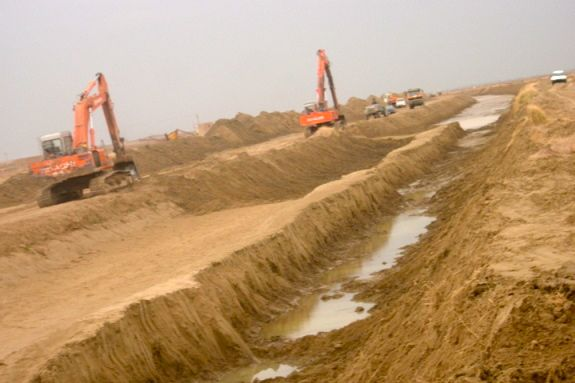The canal was not all dug by hand - we rented every excavator in the Province too for the harder sections of the canal