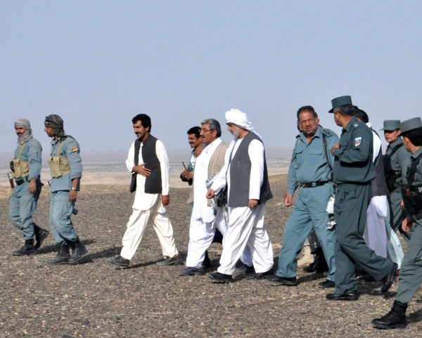 Governor Barahwi walking along with the Provincial Chief of Police and Haji the Chief of the Highway Police and the man who fought his way out of the ambush last week is directly on the Governor's left